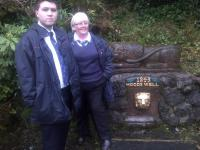Station staff members Barry Limbert and Elaine Phillips with the restored Hood's Well at Port Glasgow Station. The public fountain dates from 1843 when James Hood, the first stationmaster at Port Glasgow (opened 1841), retired - this being his choice of retirement gift. The well was re-discovered during vegetation clearance in 2001.<br><br>[John Yellowlees&nbsp;06/11/2015]
