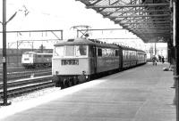 An Anglo-Scottish service arrives at Crewe on 26 April 1969 behind a class 86 electric locomotive, with another of the class standing in the background. <br><br>[John Furnevel&nbsp;26/04/1969]