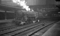 The north end of a cold and wet Carlisle platform 4 on 23 January 1965 sees Crewe North's Britannia Pacific no 70051 <I>Firth of Forth</I> waiting patiently for the road to Upperby shed, having recently arrived on the other side of the station with a terminating parcels train from the south.<br><br>[K A Gray&nbsp;23/01/1965]