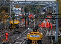 During the first day of the engineering possession, a contractor's engineering team works on the first half of the new facing crossover which has been installed on the down line just past the end of the Anniesland eastbound platform.<br><br>[Colin McDonald&nbsp;07/11/2015]