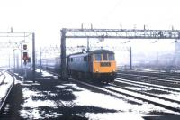 An up WCML express about to run south through Rugby on a snowy March day in 1979. [Ref query 5976]<br><br>[John Furnevel&nbsp;12/03/1979]