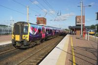 A TransPennine service from Scotland calls at Wigan North Western on 15 July 2015 en route to Manchester Airport. On the right a Northern Electrics stopping service to Liverpool Lime Street awaits its scheduled departure time.<br><br>[John McIntyre&nbsp;15/07/2015]