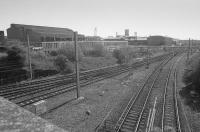 View over Milnwood / Mossend South Junction with lines diverging to Holytown, Coatbridge Central and Bellshill. In the background is British Steel Tubes division's Clydesdale Mill. A further line in the 'V' of the junction served Mossend Yard's down yard.<br><br>[Bill Roberton&nbsp;01/05/1991]