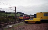 47773 with a headboard 'The Capital Express' heads south at Beattock with a rake of maroon Mk1 coaches on 06 August 1994. The yellow BR vans add a bit of colour to the shot on what was a rather dull day.<br><br>[John McIntyre&nbsp;06/08/1994]