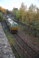 The railhead treatment unit returning to Mossend  shortly afte rSunnyside Junction on the Whifflet Loop on the 30th of October. Barely visable through the trees is the 311 unit (311 103) stored at Summerlee Heritage Park.<br><br>[Alastair McLellan&nbsp;30/10/2015]
