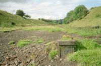 The remains of the distant signalpost for Borthwick Bank Signalbox in a view looking towards Edinburgh in 2002. 13 years on, it's a bit different here now.<br><br>[Ewan Crawford&nbsp;//2002]