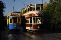 In late autumn morning sunshine the Beamish tramway prepares for a busy Sunday. Both vehicles advertise a Department Store well known to generations of North East shoppers.<br><br>[Brian Taylor&nbsp;01/11/2015]