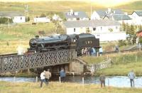 Black 5 5025 on the bridge over the River Bran just west of the platform at Achnasheen, where it paused to take on water on Saturday 25 September 1982. The locomotive was hauling the Scottish Steam Railtours Group <I>'Raven's Rock Express'</I> from Inverness to Kyle of Lochalsh. The special was advertised as <I>'The first public steam-hauled run to Kyle after an absence of 20 years'</I>.<br><br>[John Robin&nbsp;25/09/1982]