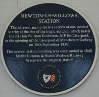 A blue plaque explains the replica memorial that is fixed inside the station building at Newton-le-Willows relating to the first railway fatality.<br><br>[John McIntyre&nbsp;09/10/2015]