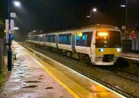 The late running 18.13 to Marylebone arrives at a soaking wet Haddenham and Thame Parkway on 6 November. I had arrived via the new curve at Bicester [see image 47183].<br><br>[Ken Strachan&nbsp;06/11/2015]