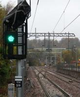 At the newly-installed-but not-yet-commissisioned junction with the Maryhill line, both photographer and route indicator had bags over their heads for different reasons on a very wet 10th November 2015. <br><br>[Colin McDonald&nbsp;10/11/2015]