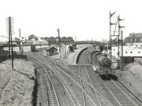 Ex-LMS 0-6-0 44330 leaving Newton-on-Ayr on 4 July 1959 with a Kilmarnock - Ayr train. <br><br>[G H Robin collection by courtesy of the Mitchell Library, Glasgow&nbsp;04/07/1959]