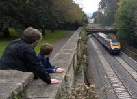 Sydney Gardens, Bath has long been a classic location to watch and photograph trains. This is the High Level viewing gallery see image [[52886]]. A father and son enjoy the spectacle as an up HST powers away from Bath Spa through the gardens.<br><br>[Ken Strachan 10/10/2015]