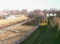 A <I>Calder Valley</I> BRCW Class 110 DMU passes through the closed station of St Lukes on a service from Manchester to Southport in 1980. This was known as the Preston platform and had closed in 1968. Another on the direct Wigan line had closed in 1965. The station has since been completely cleared away but the tracks still widen at this point to pass under the road bridge.  <br><br>[Mark Bartlett&nbsp;//1980]