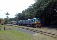 Two colourful locos at the head of the 15.30 train to Cairns wait for departure time at Kuranda in Queensland.<br><br>[Colin Miller&nbsp;27/09/2015]