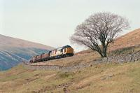Southbound freight starting round the Horseshoe Curve south of Bridge of Orchy in 1991.<br><br>[Ewan Crawford&nbsp;//1991]