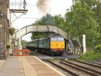 A Great Yarmouth - Norwich service formed by locomotive hauled stock operating in T&T formation pulls away from the Brundall stop on 9 June 2015. DRS 47813 is the leading locomotive with 47818 at the rear. These operations have become necessary due to a shortage of serviceable DMUs.  <br><br>[Ian Dinmore&nbsp;09/06/2015]