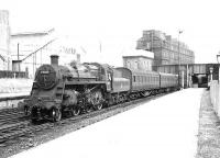BR Standard Mogul 77015 at the south end of Ayr station on 8 August 1955 with empty stock. <br><br>[G H Robin collection by courtesy of the Mitchell Library, Glasgow&nbsp;08/08/1955]