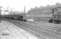 A Stirling-Edinburgh Princes Street train arrives at Larbert on 21 February 1953. The locomotive is Pickersgill ex-Caledonian 4-4-0 no 54503.<br><br>[G H Robin collection by courtesy of the Mitchell Library, Glasgow&nbsp;21/02/1953]