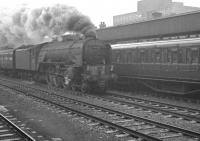 A Glasgow Queen Street - Kings Cross train takes the centre road through a wet and overcast Doncaster on 11 April 1963 behind A1 Pacific no 60150 <I>Willbrook</I>.<br><br>[K A Gray&nbsp;11/04/1963]