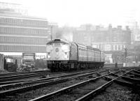 An unidentified type 2 takes a westbound train away from Haymarket on 25 April 1980. The train is passing between Haymarket coal depot on the left and Haymarket East Junction on the right.<br><br>[John Furnevel&nbsp;25/04/1980]