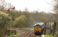 One of the DRS class 47 T&T operated services on its way back from Great Yarmouth to Norwich on 18 April 2013. The set is about to pass Brundall signal box, having run via the Berney Arms route.<br><br>[Ian Dinmore&nbsp;18/04/2013]