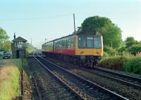 A DMU heading for Cumbernauld passing Greenfoot Level Crossing in 1989.<br><br>[Ewan Crawford&nbsp;//1989]