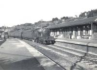 Parkhead V1 67674 entering Hillfoot station, shortly after setting out from Milngavie with a train for Airdrie in July 1957. <br><br>[G H Robin collection by courtesy of the Mitchell Library, Glasgow&nbsp;02/07/1957]