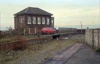 Tay Bridge South box viewed from the platforms of the closed Wormit station in 1989. Perhaps the signalman likes red cars [see image 3990] for a similar view 16 years later, by which time the box was painted red.<br><br>[Ewan Crawford&nbsp;//1989]
