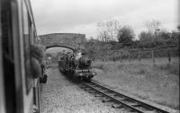 A view from an eastbound train arriving at Irton Road on the Ravenglass and Eskdale Railway as a service for Ravenglass waits in the loop on 30 May 1972.<br><br>[John McIntyre&nbsp;30/05/1972]