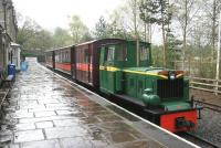 A wet day at Alston on 6 May 2006. At the platform is South Tynedale Railway No 4  <I>Naworth</I> [Hudswell Clarke 0-6-0DM No 4 of 1952]. This example was originally supplied to the NCB as an underground flameproof mine locomotive, suitably modified and distributed by the Huwood Mining Machinery Co of Team Valley, Gateshead. No 4 was previously employed at Horden Colliery in County Durham. The manufacturers nameplate displayed on the front of the locomotive is Huwood-Hudswell. <br><br>[John Furnevel&nbsp;06/05/2006]