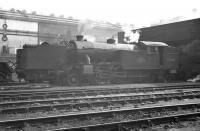 Looking south across the shed yard at Heaton around 1960 with V3 67605 in the foreground. The ECML runs behind the camera and the wall of Parsons Engineering works on Shields Road forms the backdrop, standing just beyond the North Tyneside electrified lines. <br><br>[K A Gray&nbsp;//1960]