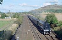 60009 'Union of South Africa' (during the 'Osprey' period) passes Auchterarder with the southbound 'Elizabethan' special in 1990. The box was switched out. This photograph was taken to compare with R Hobbs photograph in 'Scottish Steam in Colour' page 47. <br><br>[Ewan Crawford&nbsp;//1990]
