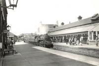 BR Standard Class 4 2-6-0 no 76092 entering Saltcoats station on 22 August 1957 with a Largs - St Enoch train. The locomotive had been delivered new to Corkerhill from Horwich works two months earlier. <br><br>[G H Robin collection by courtesy of the Mitchell Library, Glasgow&nbsp;22/08/1957]