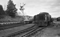 BR Class 37 no 37114 prepares to depart from Boat of Garten back to Aviemore light engine after having brought in the 'Royal Scotsman' in April 1986. On the right is an NBL 0-4-0 DH shunter stabled in front of ex LMS Black 5 no 5025.<br><br>[John McIntyre&nbsp;27/04/1986]