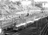 Looking east from a point above Primrose Hill tunnel on 12 September 1969. Emerging from the dive-under on the slow lines from Euston is a class 310 EMU operating an outer suburban service to Northampton. The WCML fast lines are just visible on the right, while over on the left is the through freight-only link to Camden Road and the North London Line.<br><br>[John Furnevel&nbsp;12/09/1969]