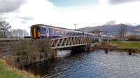 The midday service to Mallaig crosses Banavie Swing Bridge over the Caledonian Canal in 2013.<br><br>[Ewan Crawford&nbsp;27/04/2013]