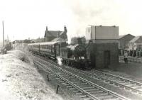 The BLS Bathgate and District Railtour of 6 May 1961 ran from Maryhill Central and covered various branches between Glasgow and the West Lothian town before finally returning to Queen Street. The special, which was hauled throughout by Eastfield shed's N15 0-6-2T no 69163, is seen here taking water at Baillieston on the outward journey. [See image 48701]<br><br>[G H Robin collection by courtesy of the Mitchell Library, Glasgow&nbsp;06/05/1961]