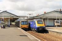 Pacer 143603, on a local service for Paignton, meets a Paddington bound HST at Newton Abbott station. 43009 is leading the London service and, on the far left, another Pacer can just be seen waiting to go forward to Exeter and Exmouth once the express has departed. <br><br>[Mark Bartlett&nbsp;29/07/2015]