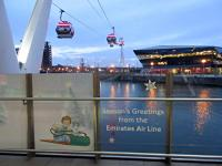 Billy and the Snowdog feature in the bottom left of this view of the Emirates Air Line passing over the Royal Victoria Dock. The View looks south showing the route of the cable car over the dock, 'The Crystal', and the River Thames to Greenwich.<br><br>[John Yellowlees&nbsp;30/11/2015]