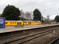 31233 on a Network Rail train waiting to head east.<br><br>[Peter Todd&nbsp;04/12/2015]
