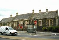 Closed in 1970 along with the line to Ilfracombe, the Barnstaple Town station building still stands on Castle Quay. Since closure, the restored structure has seen use as a restaurant and later as a school. The former station is seen here in June 2002. [See image 26577]<br><br>[Ian Dinmore&nbsp;05/06/2002]
