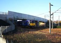 The 1049 Newton - Glasgow Central passes under the now reopened Old Mill Road bridge across the WCML at Cambuslang on 10th December 2015. [see image 51404].<br><br>[Colin McDonald&nbsp;10/12/2015]