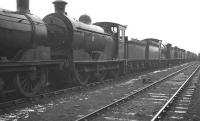 A lineup of stored locomotives awaiting disposal alongside Bo'ness Harbour in February 1962 following a shower of rain. Directly ahead stands J35 0-6-0 no 64472, not officially withdrawn from Kipps shed until the following month. The locomotive was eventually cut up at Connel's of Coatbridge in November of that year.<br><br>[K A Gray&nbsp;26/02/1962]
