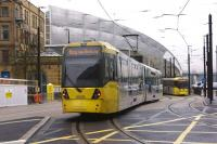 Metrolink trams approach and depart from Manchester Victoria on 10 December. These trams are on the original route via Piccadilly Gardens. To the left is the second city crossing via Exchange Square.<br><br>[John McIntyre&nbsp;10/12/2015]