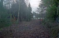 The end of the platform (right) at Strathblane in 1990 looking east over the former station site. [See image 9073].<br><br>[Ewan Crawford&nbsp;//1990]