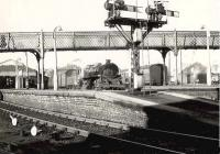 Looking across the platforms towards the shed at Helensburgh Central on a bright 26 October 1957. Standing at the platform is BR Standard class 4 2-6-0 no 76102, which had arrived new at Parkhead from Doncaster works some 4 months earlier.  <br><br>[G H Robin collection by courtesy of the Mitchell Library, Glasgow&nbsp;26/10/1957]