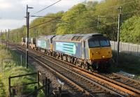 Two DRS Class 57s take the evening flask train south along the WCML in May 2015. 57012 and 57002 have just passed Scorton and are approaching the footbridge at Broad Fall Farm.  <br><br>[Mark Bartlett&nbsp;13/05/2015]