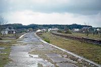 Rain is about to dampen the disused and crumbling platforms of Cromer High station on 2nd May 1976. There had been no trains here since 1960 when the site was used as a depot for materials scavenged from the recently closed M&GN system. Passenger trains ceased to call in 1954.<br><br>[Mark Dufton&nbsp;02/05/1976]