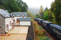 Site of Killiecrankie station looking south with 66422 leading a Stobart train south. The bridge this photograph is taken from crossed over the two platforms.<br><br>[Ewan Crawford&nbsp;02/10/2009]